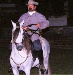 Actor portraying Captain Bowie riding a horse